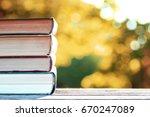 autumn book stack wooden outdoor | Shutterstock . vector #670247089