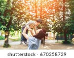 young mother with her little... | Shutterstock . vector #670258729