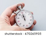 analogue metal stopwatch. | Shutterstock . vector #670265935