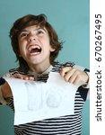 teenager boy tear his drawing... | Shutterstock . vector #670267495