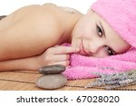 Beautiful young woman delights in by the massage - stock photo