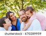 portrait of happy parents and... | Shutterstock . vector #670289959