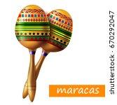beautiful maracas on white... | Shutterstock .eps vector #670292047