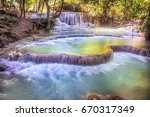 the kuang si falls  sometimes... | Shutterstock . vector #670317349