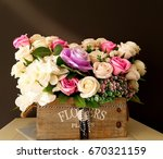 various flowers in a flower box. | Shutterstock . vector #670321159