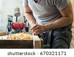 a close up as a young man holds ... | Shutterstock . vector #670321171
