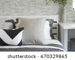 beige cushion on bed at home | Shutterstock . vector #670329865