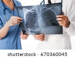 two doctors examined the x ray  ... | Shutterstock . vector #670360045