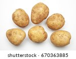 Raw Potato Isolated On White...