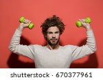 handsome man with barbell or... | Shutterstock . vector #670377961