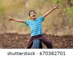rural indian child | Shutterstock . vector #670382701