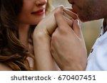 man kissing woman's hand   Shutterstock . vector #670407451