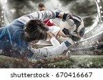 goalkeeper catches the ball in... | Shutterstock . vector #670416667