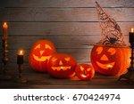 halloween pumpkin on wooden... | Shutterstock . vector #670424974