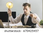 crazy businessman with lamp... | Shutterstock . vector #670425457