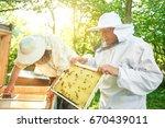 two cheerful senior male... | Shutterstock . vector #670439011