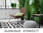 cozy armchair in modern green... | Shutterstock . vector #670465177