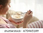 bowl with yogurt and spoon in... | Shutterstock . vector #670465189