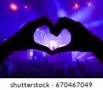music concert  hands raised in... | Shutterstock . vector #670467049