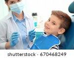 dentist examining little boy's... | Shutterstock . vector #670468249