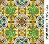 mandala flower coloring book...   Shutterstock .eps vector #670474669