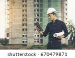 engineer wearing a black shirt  ... | Shutterstock . vector #670479871