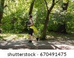 overweight woman running.... | Shutterstock . vector #670491475