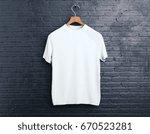 wooden hanger with empty white... | Shutterstock . vector #670523281