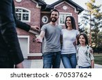 happy family is taking keys... | Shutterstock . vector #670537624