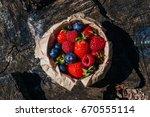 fresh berries on wooden...   Shutterstock . vector #670555114