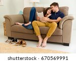 young couple sitting on the... | Shutterstock . vector #670569991