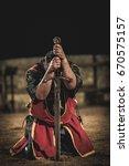 medieval knight kneeling with... | Shutterstock . vector #670575157