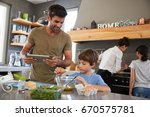 family in kitchen following... | Shutterstock . vector #670575781