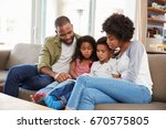 family sitting on sofa in... | Shutterstock . vector #670575805