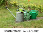 old metal watering can on the... | Shutterstock . vector #670578409