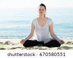 female in white t shirt is... | Shutterstock . vector #670580551