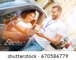 smiling woman listening to car... | Shutterstock . vector #670586779