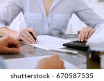 bookkeepers or financial... | Shutterstock . vector #670587535