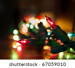 colorful christmas lights running along a mantelpiece, selective focus on single light - stock photo