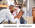 father saying goodbye to son as ... | Shutterstock . vector #670592224