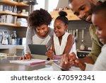 parents helping children with... | Shutterstock . vector #670592341