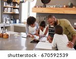 parents helping children with... | Shutterstock . vector #670592539