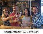 portrait of happy friends... | Shutterstock . vector #670596634