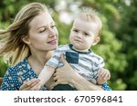 beautiful happy mather with... | Shutterstock . vector #670596841
