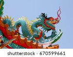 Small photo of Handsome Chinese art decorations and dragon decorated with green tile sky blue background light.Place the assembled religious rituals. Amp hoe ban La em patchable, Thailand country.