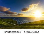 solar panels at sunrise with... | Shutterstock . vector #670602865
