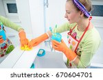 housemaid cleaning a bathroom ... | Shutterstock . vector #670604701