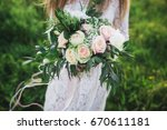 girl with a beautiful bouquet.... | Shutterstock . vector #670611181