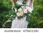 girl with a beautiful bouquet.... | Shutterstock . vector #670611181