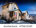 Cabin In The Snow With Usa Flag